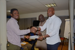 Mr. Ato Afful, the Resource Person giving out certificate to a male participants