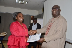 Mr. Francis Dadzie giving out certificate to a lady participant