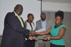 : A lady participant receiving her certificate from Mr. Joel Nettey, AAG President