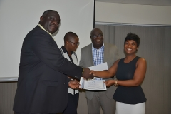 The President of AAG, Mr. Joel Nettey presenting certificate to a Lady participant