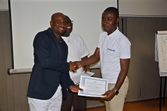 A male participant receiving his certificate from Mr. Clarence Nartey, the Resource Person