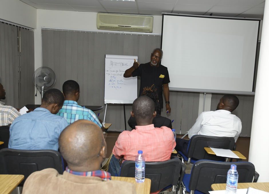 Participants listening to the Resource Person