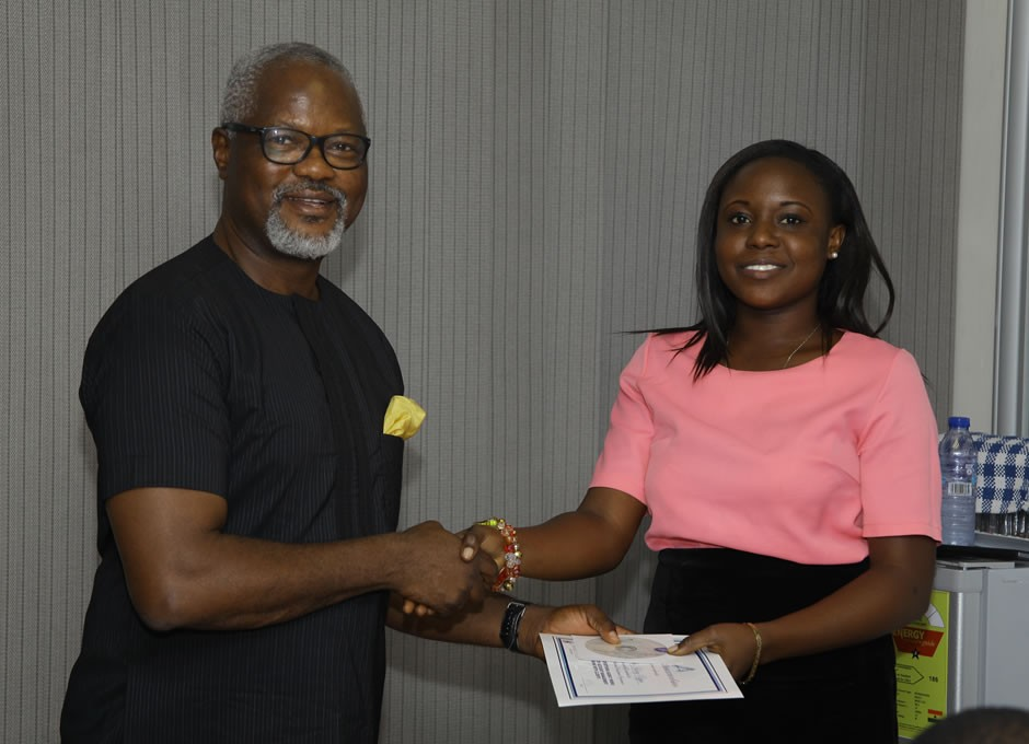 A lady participant receiving her certificate